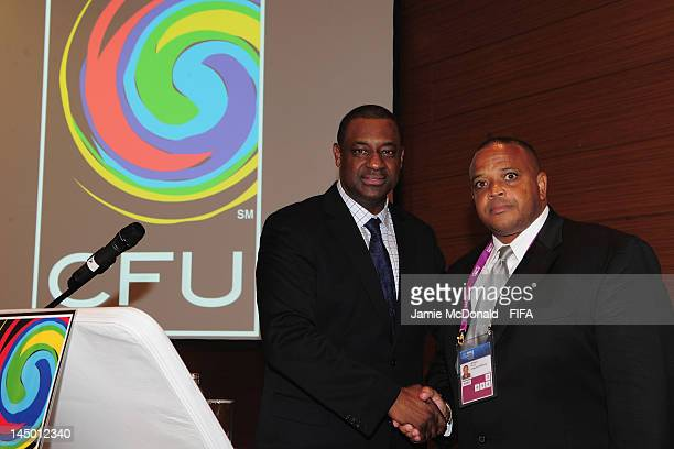 Gordan Derrick the new President of the Caribbean Football Union shakes hands with Chairman of the CFU Normalisation Committee Jeffrey Webb during...