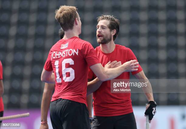 Gordan Johnston of Canada and Iain Smythe of Canada embrace after the 5th/6th place match between India and Canada on day nine of the Hero Hockey...