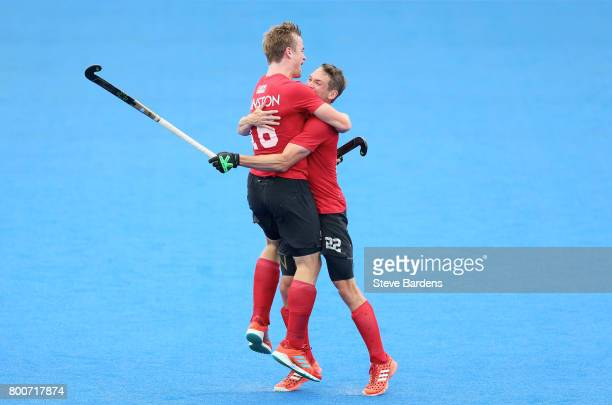 Gordan Johnston of Canada celebrates scoring their teams third goal wiht teammate John Smythe of Canada during the 5th/6th place match between India...