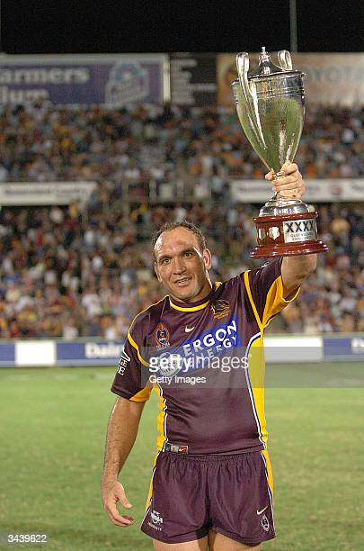 Gorden Tallis of the Broncos holds the XXXX Cup aloft after the NRL match between the North Queensland Cowboys and the Brisbane Broncos at Dairy...