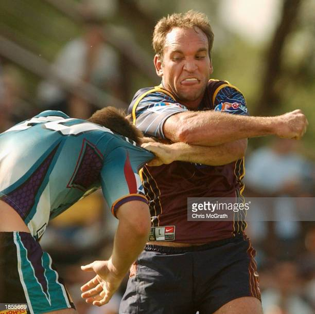 Gorden Tallis of the Broncos punches Ben Ross of the Panthers during the round one NRL match between the Penrith Panthers and the Brisbane Broncos...