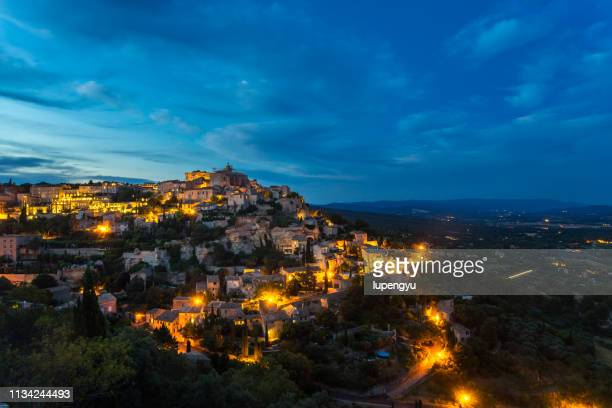 gordes in provence, france at dusk - abyss by abby stock pictures, royalty-free photos & images