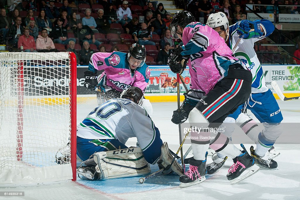 Gordie Ballhorn #4 and Tomas Soustal #15 of Kelowna Rockets try to score a goal against Taz Burman on October 15, 2016 at Prospera Place in Kelowna, British Columbia, Canada.