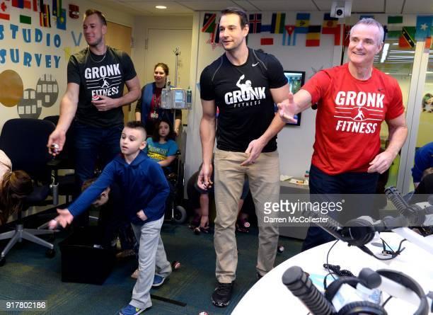 Gordie Gronkowski Jr Dan Gronkowski and Gordy Gronkowski play Olympic beanbag toss with Jacob at Boston Children's Hospital on February 13 2018 in...