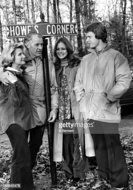 Gordie Howe and his wife Colleen Joffa Howe talk to son Mark Howe at their home circa 1980 in Bloomfield Hills Michigan