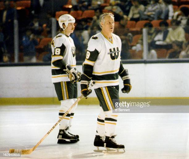 Gordie Howe and Marty Howe of the New England Whalers skate on the ice during an WHA game circa 1978 at the Hartford Civic Center in Hartford...