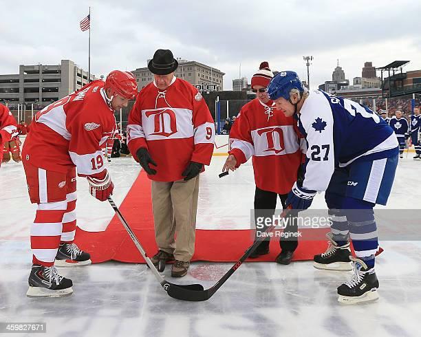 Gordie Howe and Ted Lindsay drop the ceremonial pucks between Steve Yzerman of the Detroit Red Wings Alumni and Darryl Sittler of the Toronto Maple...