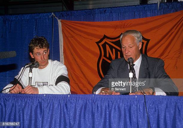 Gordie Howe and Wayne Gretzky of the Los Angeles Kings talk to the press after Gretzky broke Howe's career points record during the game against the...
