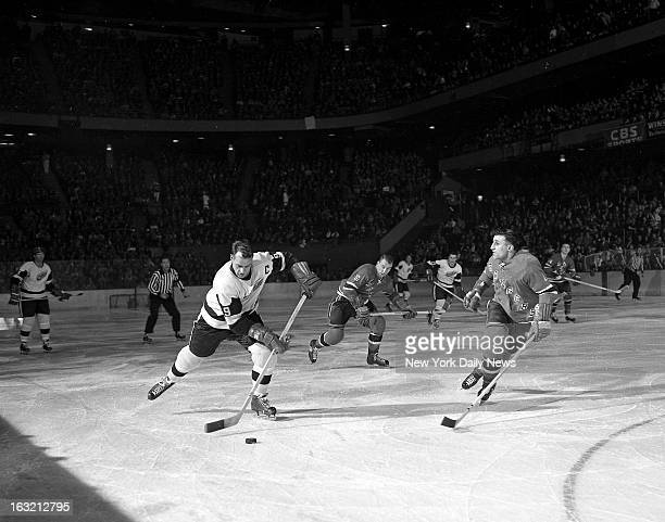 Gordie Howe of the Detroit Red Wing who needed but two points in Madison Square Garden game to replace Maurice Richard as the top scorer in NHL...