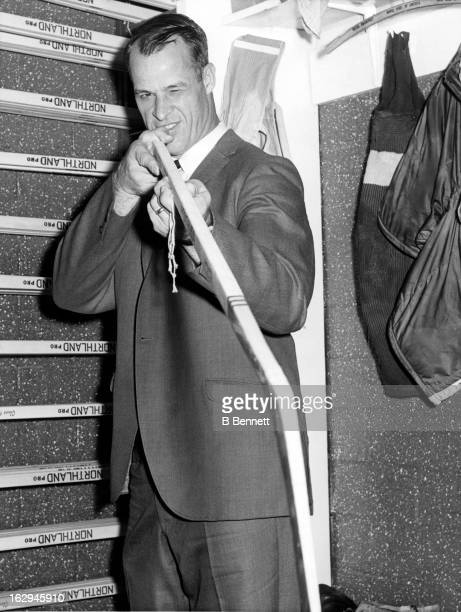 Gordie Howe of the Detroit Red Wings chooses his stick as he goes for the alltime scoring record on November 2 1964 in Detroit Michigan