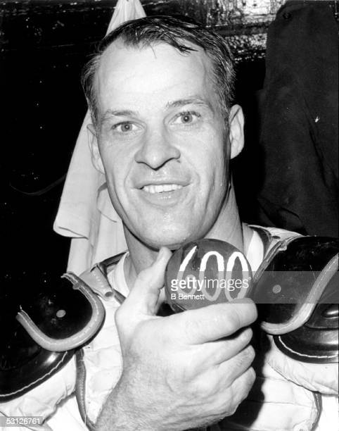 Gordie Howe of the Detroit Red Wings holds the puck that he scored his 600th career goal with from the night before against the Montreal Canadiens...