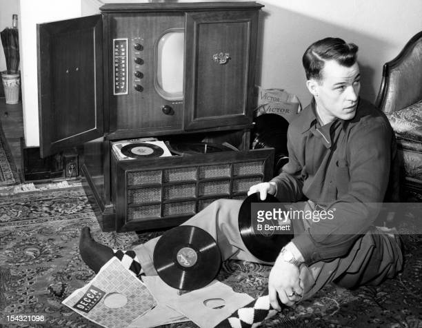 Gordie Howe of the Detroit Red Wings listens to his record collection while at home as he is the roommate of teammate Ted Lindsay on February 16 1951...