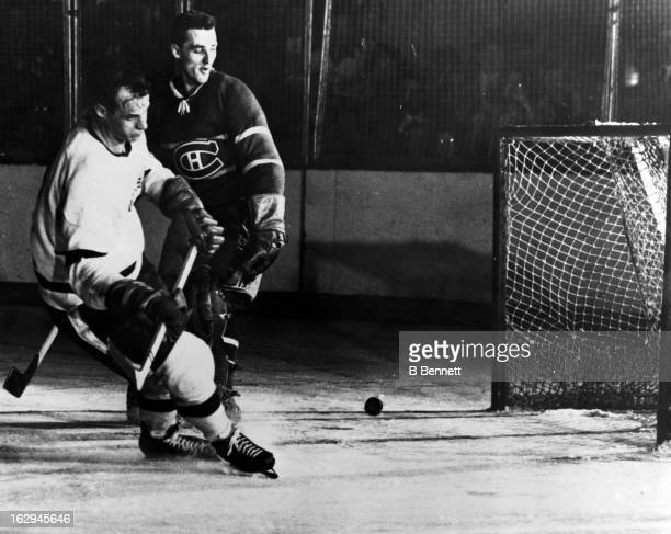 Gordie Howe of the Detroit Red Wings scores on goalie Jacques Plante of the Montreal Canadiens circa 1955 at the Montreal Forum in Montreal Quebec...