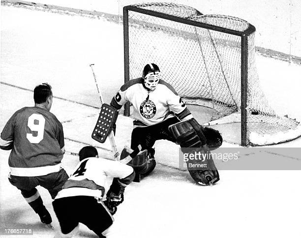 Gordie Howe of the Detroit Red Wings shoots on goalie Marv Edwards of the Pittsburgh Penguins circa 1969 at the Detroit Olympia in Detroit Michigan