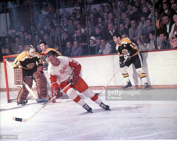 Gordie Howe of the Detroit Red Wings skates on the ice during an NHL game against the Boston Bruins circa 1968 at the Boston Garden in Boston...