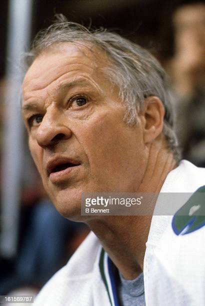 Gordie Howe of the Hartford Whalers looks on from the bench during an NHL game circa 1980 at the Hartford Civic Center in Hartford Connecticut