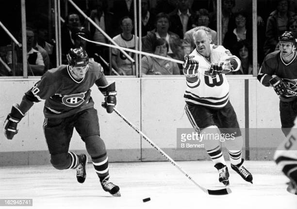Gordie Howe of the Hartford Whalers tries to hook Chris Nilan of the Montreal Canadiens during Game 3 of the Preliminary Round on April 11 1980 at...