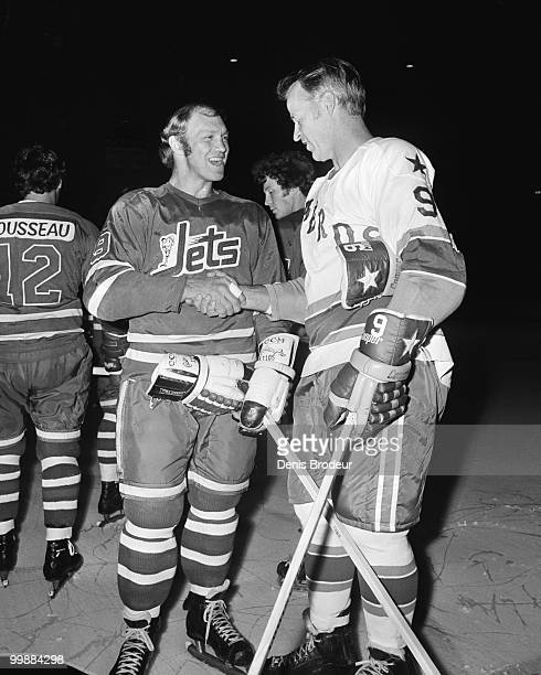 Gordie Howe of the Houston Aeros shakes hands with Bobby Hull of the Winnipeg Jets in the 1970's at the Montreal Forum in Montreal Quebec Canada