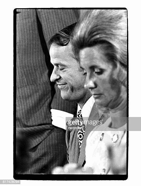 Gordie Howe sitting next to his wife Colleen seems to be enjoying some private memory as he listens with eyes closed to Detroit Red Wings' excoach...