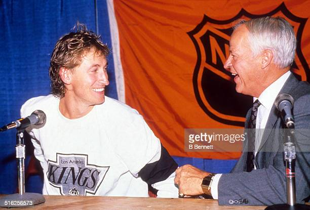 Gordie Howe stands with Wayne Gretzky of the Los Angeles Kings in the locker room after Gretzky broke Howe's career points record during the game...