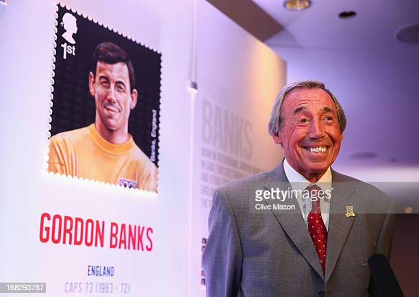 Gordon Banks poses for a TV crew in front of his stamp during the Football Association's Royal Mail Stamp Launch at Wembley Stadium on May 8 2013 in...