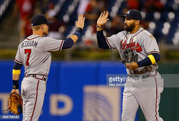 Gordon Beckham high fives teammate Matt Kemp of the Atlanta Braves after defeating the Philadelphia Phillies 84 during a game at Citizens Bank Park...