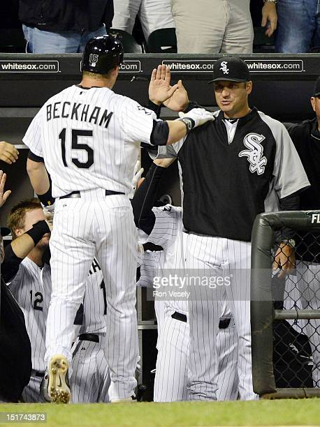 Gordon Beckham is greeted by manager Robin Ventura of the Chicago White Sox after Beckham hit a home run in the eighth inning against the Detroit...