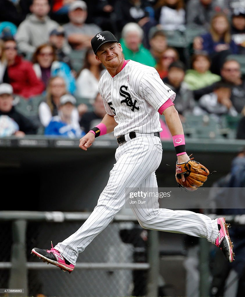 Gordon Beckham #15 of the Chicago White Sox after throwing to first base against the Cincinnati Reds during the seventh inning on May 10, 2015 at U.S. Cellular Field in Chicago, Illinois. The Chicago White Sox won 4-3.