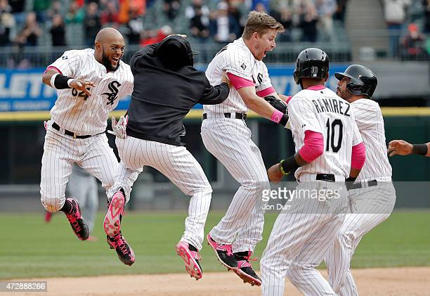 Gordon Beckham of the Chicago White Sox and the team celebrate after he hit the game winning RBI against the Cincinnati Reds during the ninth inning...