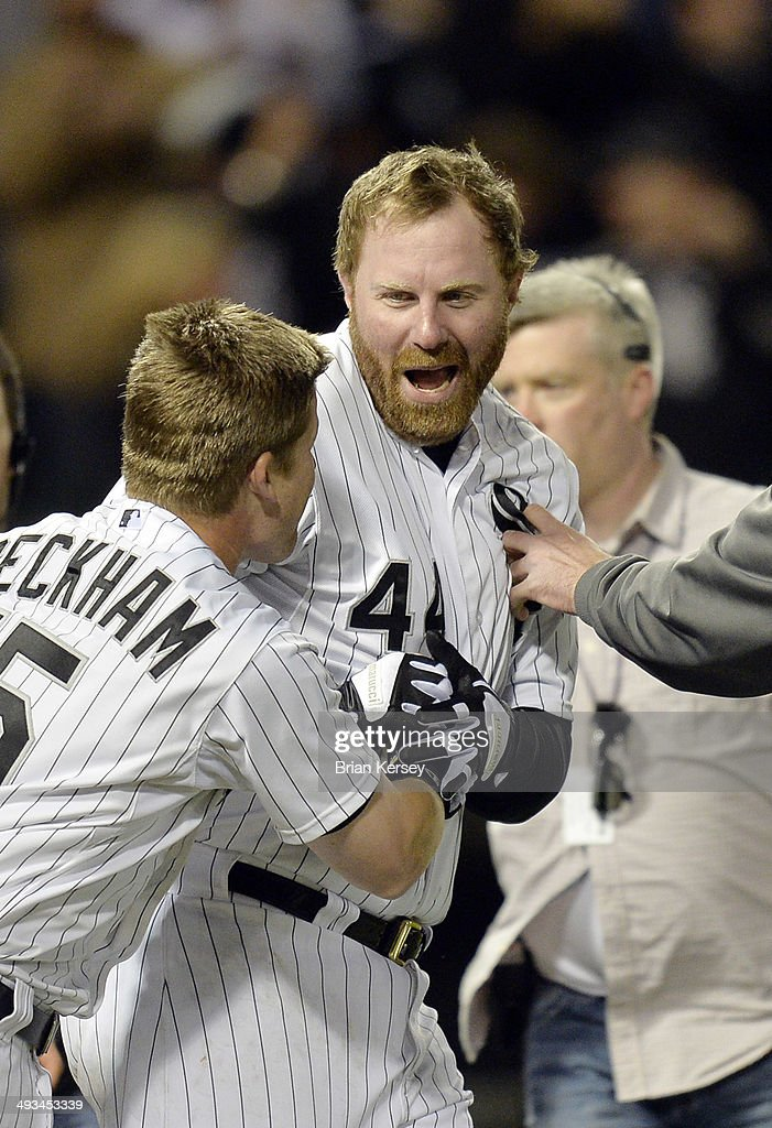 Gordon Beckham #15 of the Chicago White Sox (L) celebrates with teammate Adam Dunn #44 after Dunn hit a two-run, game winning home run scoring Moises Sierra during the ninth inning against the New York Yankees at U.S. Cellular Field on May 23, 2014 in Chicago, Illinois. The White Sox defeated the Yankees 6-5.