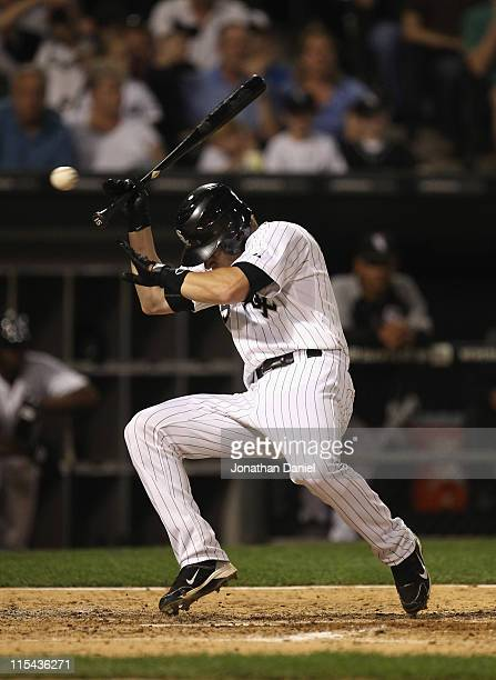 Gordon Beckham of the Chicago White Sox ducks and just misses getting hit in the head against the Seattle Mariners at US Cellular Field on June 6...
