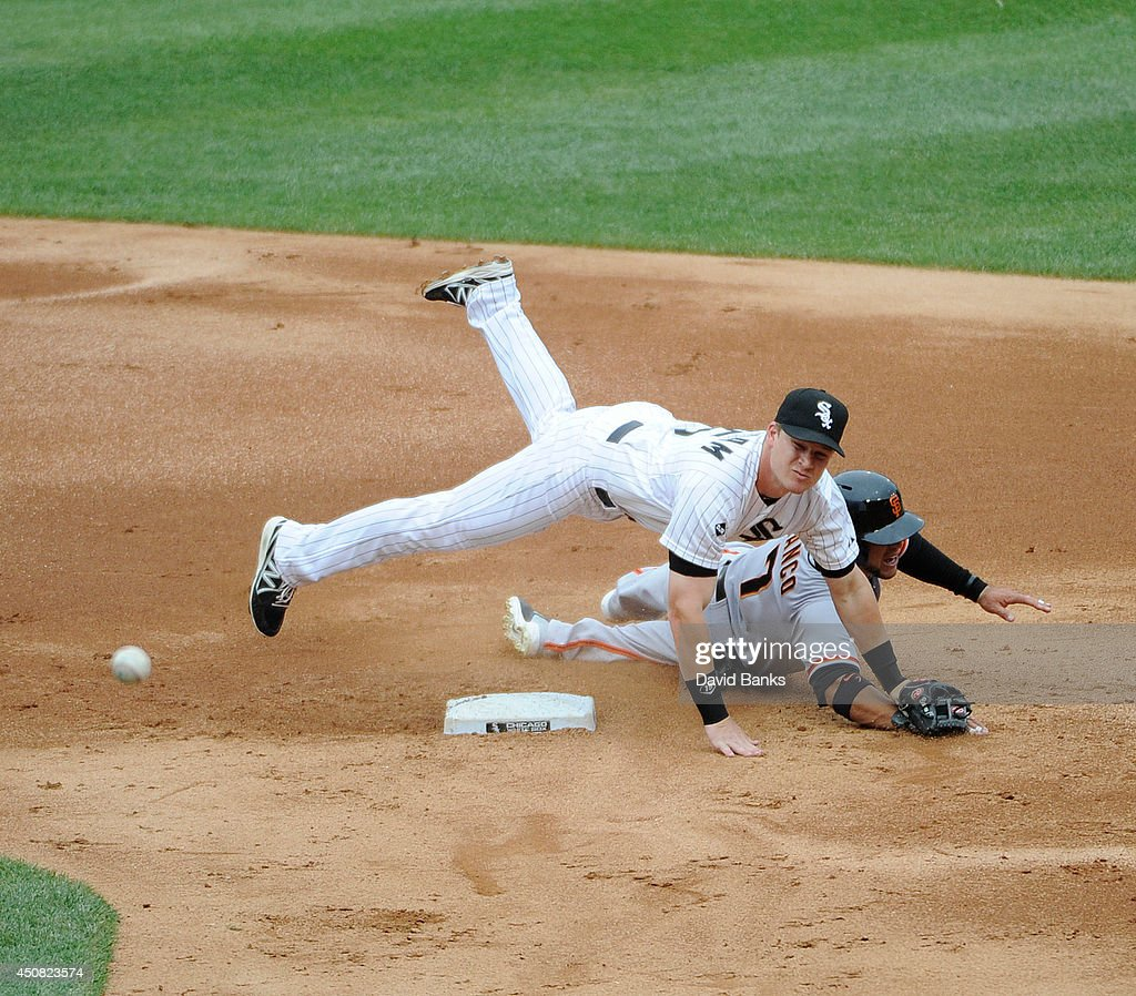 Gordon Beckham #15 of the Chicago White Sox forces out Gregor Blanco #7 of the San Francisco Giants during the third inning on June 18, 2014 at U.S. Cellular Field in Chicago, Illinois.
