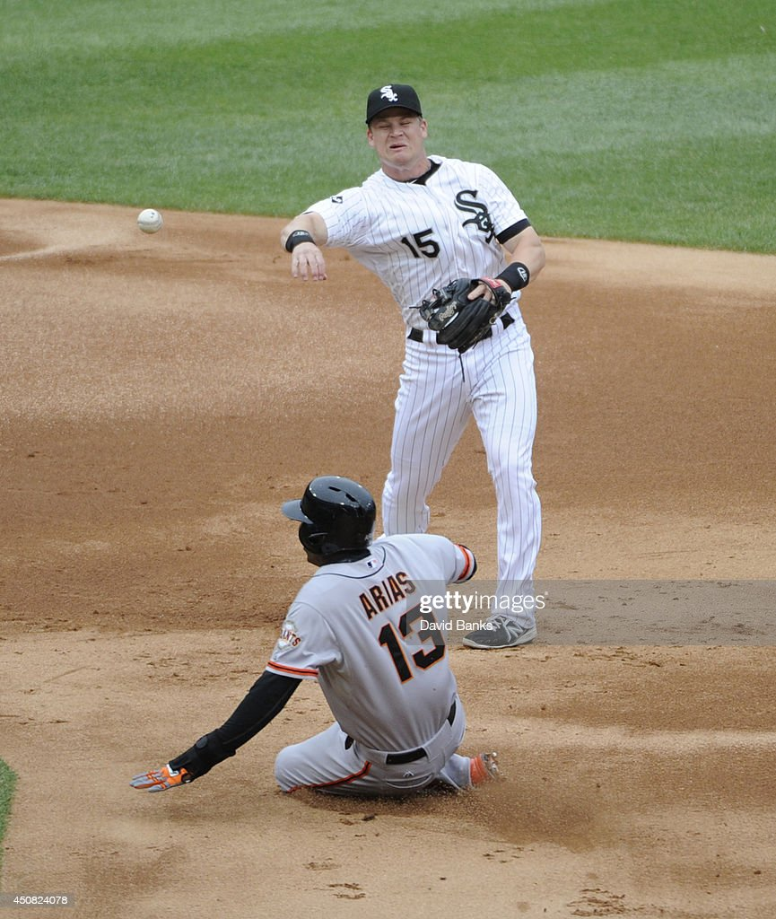 Gordon Beckham #15 of the Chicago White Sox forces out Joaquin Arias #13 of the San Francisco Giants during the second inning on June 18, 2014 at U.S. Cellular Field in Chicago, Illinois.