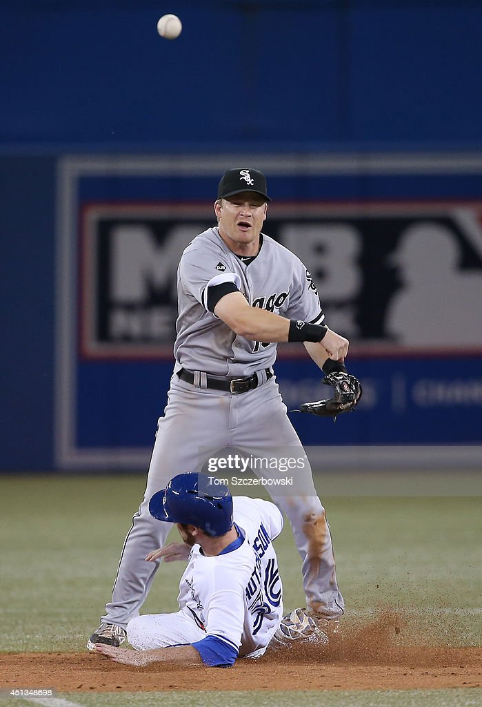 Gordon Beckham #15 of the Chicago White Sox forces out the lead runner at second base but cannot turn the double play in the ninth inning during MLB game action as Drew Hutchison #36 of the Toronto Blue Jays slides on June 27, 2014 at Rogers Centre in Toronto, Ontario, Canada.
