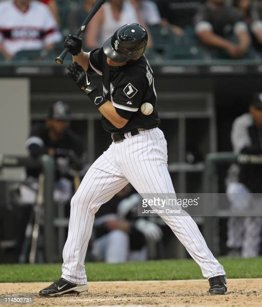 Gordon Beckham of the Chicago White Sox is hit by a pitch in the 8th inning against the Los Angeles Dodgers at US Cellular Field on May 22 2011 in...