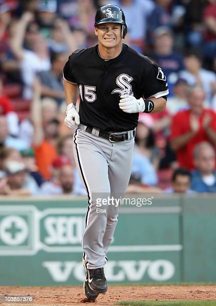 Gordon Beckham of the Chicago White Sox is unintentionally walked with the bases loaded to score the game winning run in ninth inning against the...