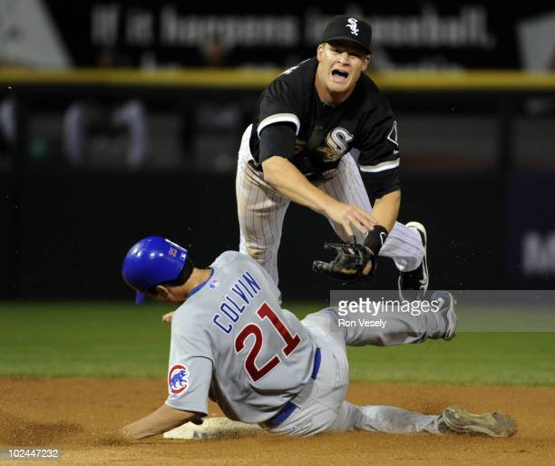Gordon Beckham of the Chicago White Sox is upended while turning a game ending double play over the sliding Tyler Colvin of the Chicago Cubs on June...