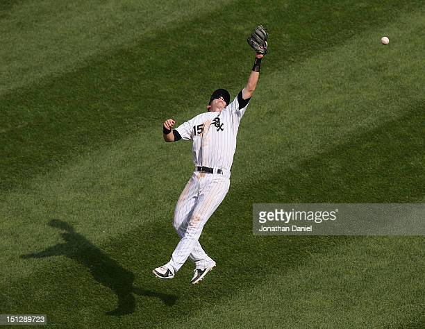 Gordon Beckham of the Chicago White Sox leaps to try and reach a hit by Eduardo Escobar of the Minnesota Twins at US Cellular Field on September 5...