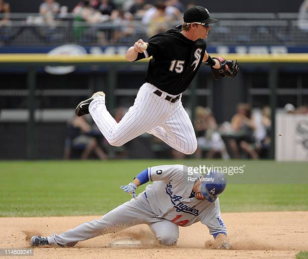 Gordon Beckham of the Chicago White Sox makes a force out at second base as Jamey Carroll of the Los Angeles Dodgers breaks up the double play in the...