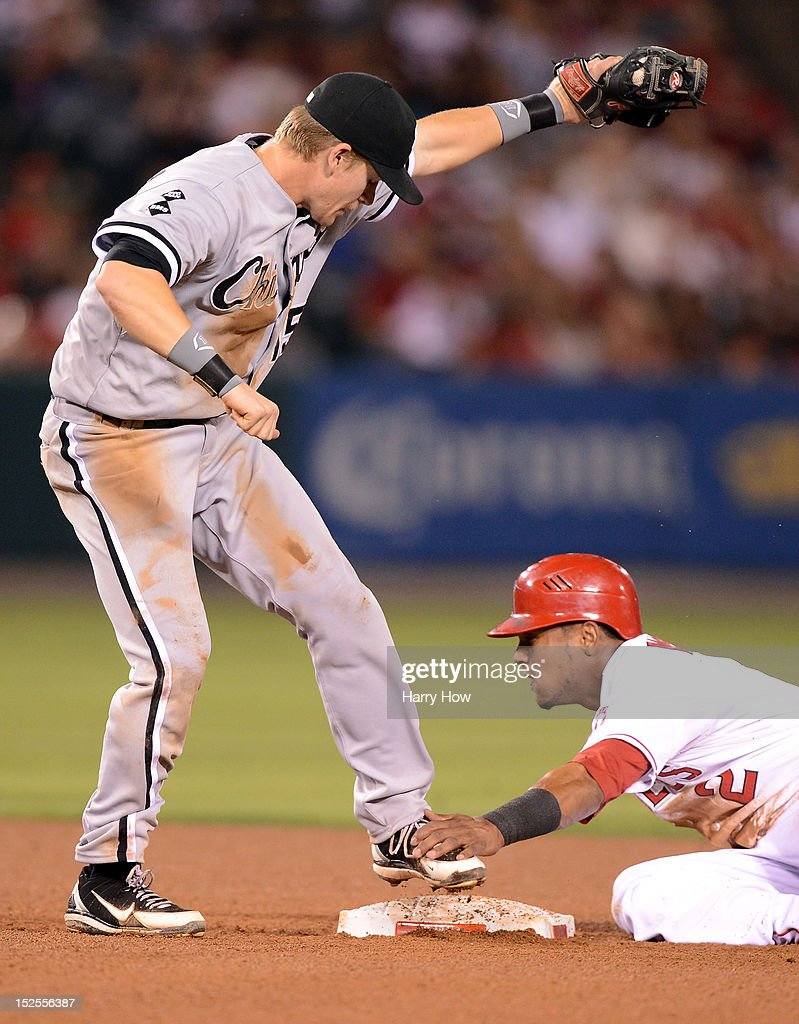 Gordon Beckham #15 of the Chicago White Sox reacts to his tag of Erick Aybar #2 of the Los Angeles Angels during a steal of second base during the fourth inning at Angel Stadium of Anaheim on September 21, 2012 in Anaheim, California. Aybar was called safe.