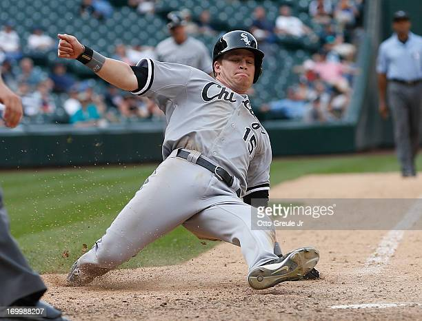 Gordon Beckham of the Chicago White Sox scores on an RBI single by Alejandro De Aza in the sixteenth inning against the Seattle Mariners at Safeco...