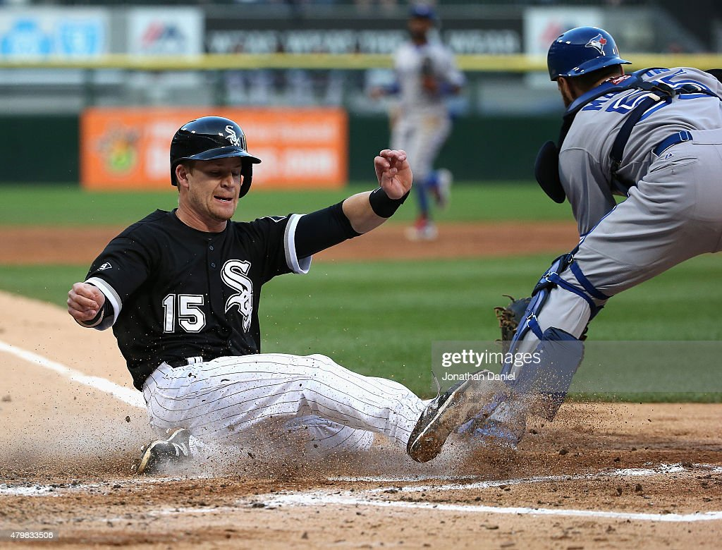 Gordon Beckham #15 of the Chicago White Sox slides in to score a run ahead of the tag attmept by Russell Martin #55 of the Toronto Blue Jays in the 2nd inning at U.S. Cellular Field on July 7, 2015 in Chicago, Illinois.