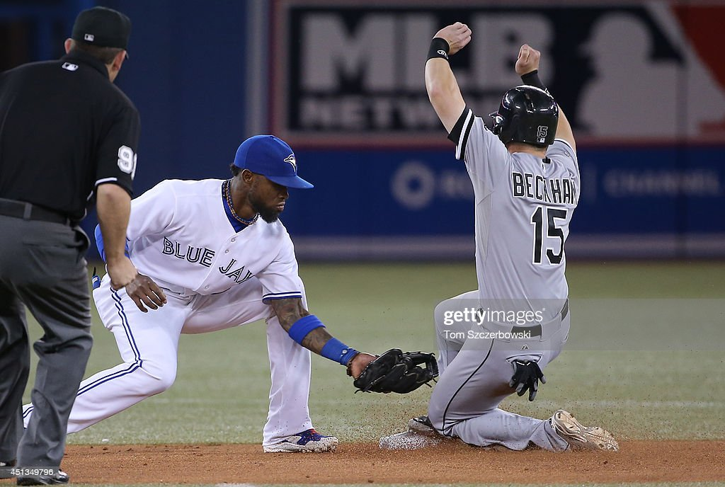 Gordon Beckham #15 of the Chicago White Sox steals second base in the eighth inning during MLB game action as Jose Reyes #7 of the Toronto Blue Jays applies the late tag on June 27, 2014 at Rogers Centre in Toronto, Ontario, Canada.