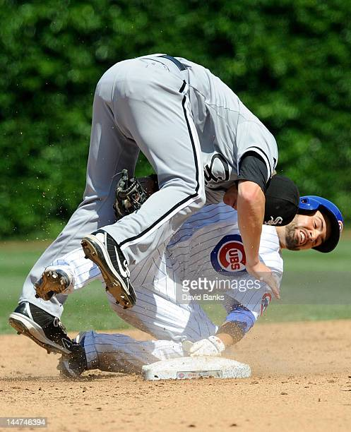 Gordon Beckham of the Chicago White Sox tags out David DeJesus of the Chicago Cubs in the fifth inning on May 18 2012 at Wrigley Field in Chicago...