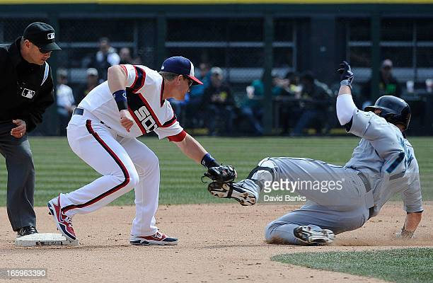 Gordon Beckham of the Chicago White Sox tags out Justin Smoak of the Seattle Mariners at second base in the seventh inning on April 7 2013 at US...