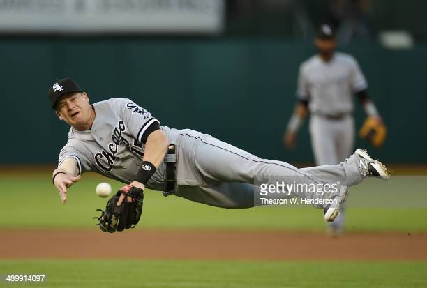 Gordon Beckham of the Chicago Whites Sox makes a throw to first base on a bunt by Craig Gentry of the Oakland Athletics in the bottom of the first...