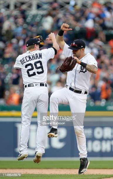 Gordon Beckham of the Detroit Tigers celebrates with Nicholas Castellanos of the Detroit Tigers after a 93 win over the Minnesota Twins at Comerica...