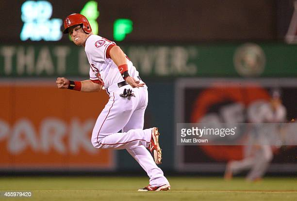 Gordon Beckham of the Los Angeles Angels of Anaheim runs the bases while blowing a bubble with a piece of gum during the game against the Houston...