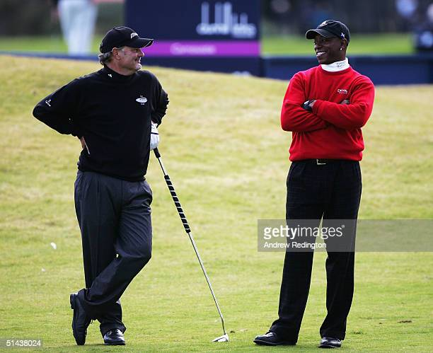 Gordon Brand Junior of Scotland shares a joke with Ian Wright, ex-footballer, on the 18th hole during the first round of of the Dunhill Links...