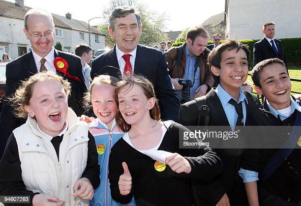 Gordon Brown chancellor of the exchequer center red tie campaigns in the Gilmerton area of Edinburgh before tomorrow's elections in Scotland UK...